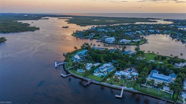 Enjoy breathtaking wide water views from one of the most highly desirable Port Royal properties to c