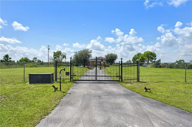 Two well cared for homes for the price of one!  A circle drive featuring a brick paved portico that