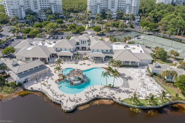 Rarely available coach home located in The Dunes, one of North Naples' most prestigious communities.