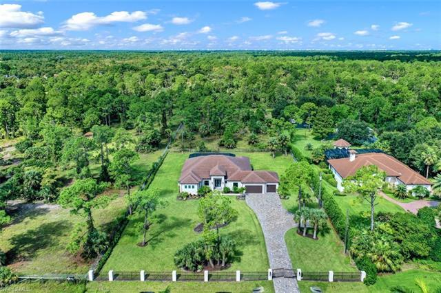 This gated and fully fenced estate home is situated on a lush 2.5 acre lot just 1.9 miles east of 95
