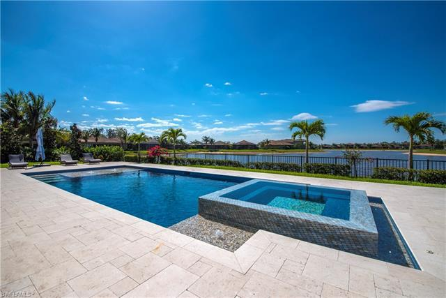 """Please Note: NO SHOWINGS UNTIL 9/13/21…Welcome to the Most desirable premium oversized lot w/ southern exposure on the largest lake in Riverstone! This Venetian model estate home has an abundance of upgrades, close to $200,000 in builder options & more: High end cabinetry, neutral rectangular tile & hand-scraped wood floors throughout, Custom window treatments, plantation shutters & light fixtures. Impact glass/sliders thru entire house! Spacious kitchen offers SS GE Profile appliances, double oven, contour door dishwasher, microwave, induction cook top & convenient chef's island all opening to Family Room and sliders out to undercover screened patio for relaxing and entertaining. Formal Living, Dining & Den. Upstairs to an open media Loft with french doors to upper balcony, surrounded by the Master Bedroom & Bath suite & 4 guest bedrooms & an additional laundry area on this level too! PLUS a magnificent custom heated Pool & Spa with water features surrounded by block pavers & fenced yard + extensive landscaping & stunning panoramic longest lake views. Set on a quiet cul de sac with a spacious 3 car garage. All this & located in the sought after """"resort style"""" amenity rich community of Riverstone and zoned for top schools!"""