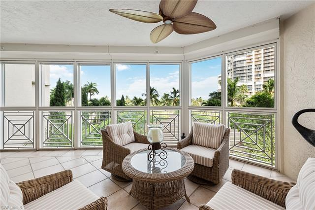 This spacious 2nd floor home is right on the beach with lovely views of the Gulf and lush landscapin