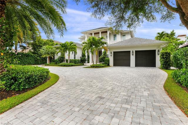 Enjoy breathtaking bay views from this spectacular Park Shore home. 2018 build with over 100 feet of