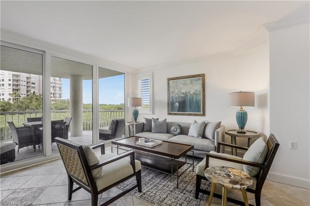 C2602 - NAPLES CAY LUXURY BEACH CONDO ~ JUST STEPS TO THE SAND! Highly desirable 3 BR/2 BA END UNIT.