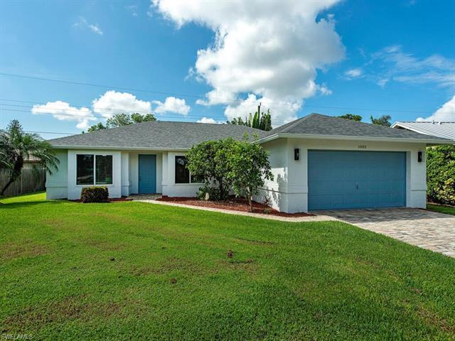 FURNISHED (Turnkey) NO ANNUAL RENTALS. UNAVAILABLE FEB 2022.  Rates vary per month from 3000-9000. This centrally located home just east of US 41 puts you close to many public beach access points yet just a few minutes drive to Old Naples. Freshly painted, furnished & decorated, the home is very clean. The primary bedroom has a King size bed with en suite Bath, glass shower door & double sinks. The primary closet is generously sized, you will not have a problem finding space for all of your things. The Guest Bedroom has a Twin over Full bunk Bed & the 3rd bedroom/den has a Queen size Murphy Bed. There is a hall bathroom with tub & shower for the two extra bedrooms to share. The Family Room, Primary Bedroom & bunk bed room all have flat scre
