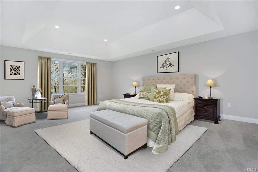 Opulent master bedroom suite accessible through double doors, generous master bath with window seat,