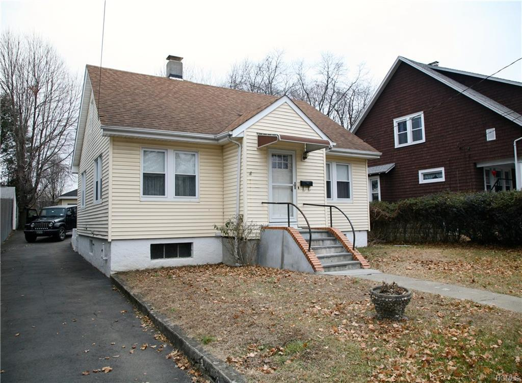 Adorable Cape Cod Home located in commercial district.  This home is located in a commercial distric