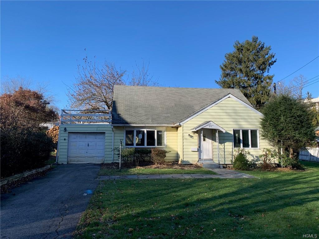 Detached corner cape on a level lot with a private backyard. This diamond in the rough is located in