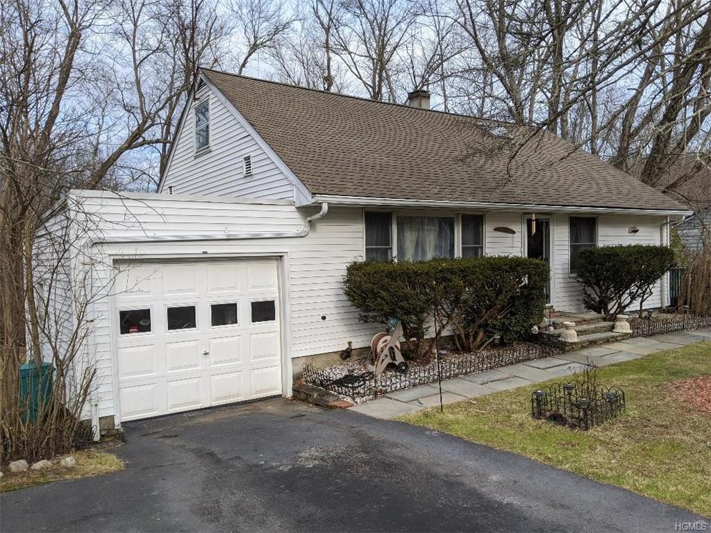 Don't miss this large Cape cod style home in Yorktown Heights.  The upper level features a Master su
