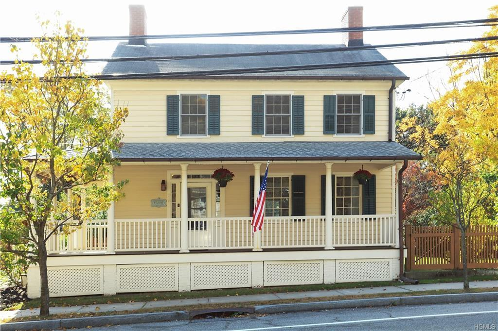 Early 19th Century Federal Style home on large village lot. Historically intact with major renovatio