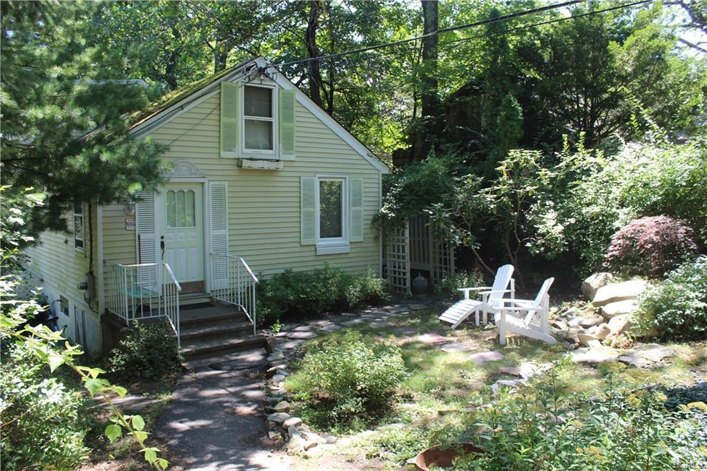 Charming and private cape on a 1 acre parcel in Lake Peekskill community in scenic Putnam Valley. Fr