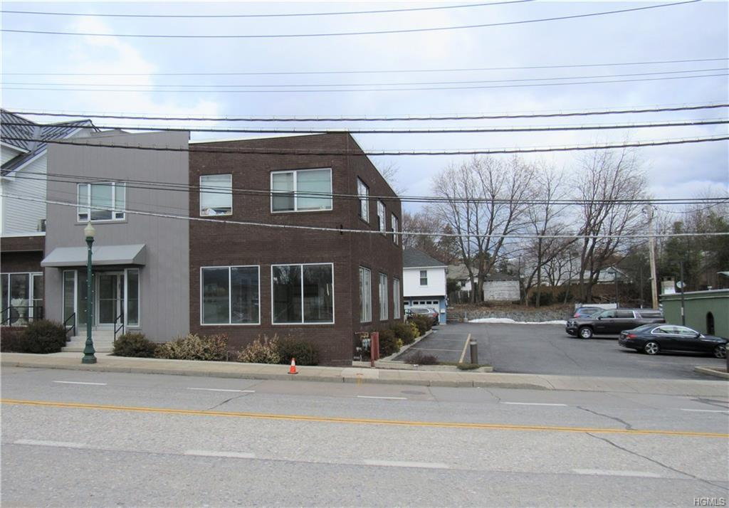 Professional light & bright office/retail space with off street parking in the Harmon section of Croton-on-Hudson. Bring your vision to create the ideal space perfect for your Dental/Medical/Attorney/Dance Studio/Office/etc. New energy efficient building (2015) w/fire sprinkler system thru-out and 9' ceilings & walls of windows. Dressing room, bathroom & two separate rooms suitable for offices or retail storage. Water fountain with bottle filler. Short walk to Metro North Train Station for a 47 min. Express  to Grand Central. Ideal location makes for easy access to NYC & major highways. Triple NNN lease $19.25 sf/yr base rent + $1.25 sf/yr CAM + $7.50 sf/yr taxes. Addt'l cost for unfinished storage in basement if needed. Owner willing to negotiate rent concession for build-out with multi year lease. Off street parking for 12 cars, including ADA compliant spot and ramp to building. Close to shopping, restaurants, river front, Van Cortlandt Manor & more for great visibility.