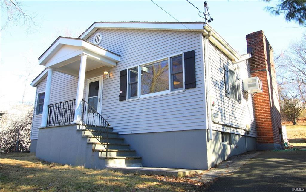 Comfortable and convenient, yet updated and stylish, this two bedroom, one bath home in the village