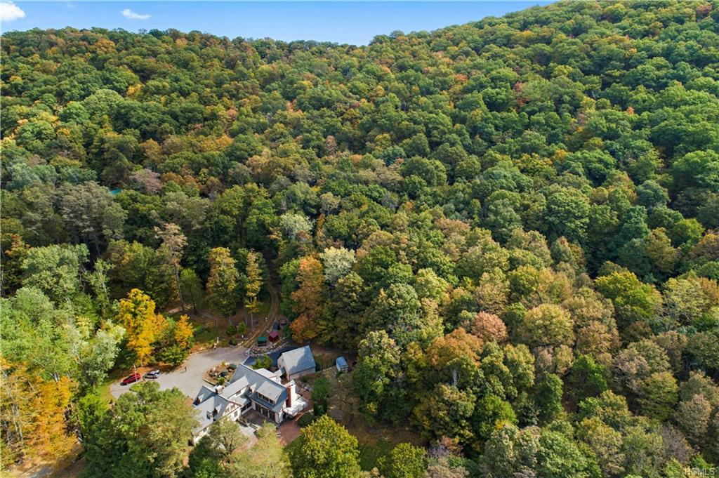 Unrivaled living in the Hudson Valley! Welcome to this luxury contemporary farm house where modern, elegant building design & luxurious finishes meet absolute privacy and serenity. Your 5192 sq. ft. oasis perfectly fits your contemporary aesthetic, while your magnificent 37 acre estate allows you to decompress and disconnect from all your urban stresses. Live life in the environment you deserve! A great room w/fireplace offers a light-filled gathering area with an open concept dining space. Chef's kitchen flows seamlessly to the open living space, w/oversized island & professional range & chef's pantry, dual wine refrigerators. Extra large master suite w/sitting room, walk-in closet, ensuite bath, fireplace & balcony. 3 additional bedrooms plus nanny suite.  Features 5 bedrooms, 4.5 baths & 2 car garage.  Included 2 sub-divided lots w/river views & a barn. Barn heated CA perfect artist loft. **Owner will hold private mortgage contact your realtor for details**