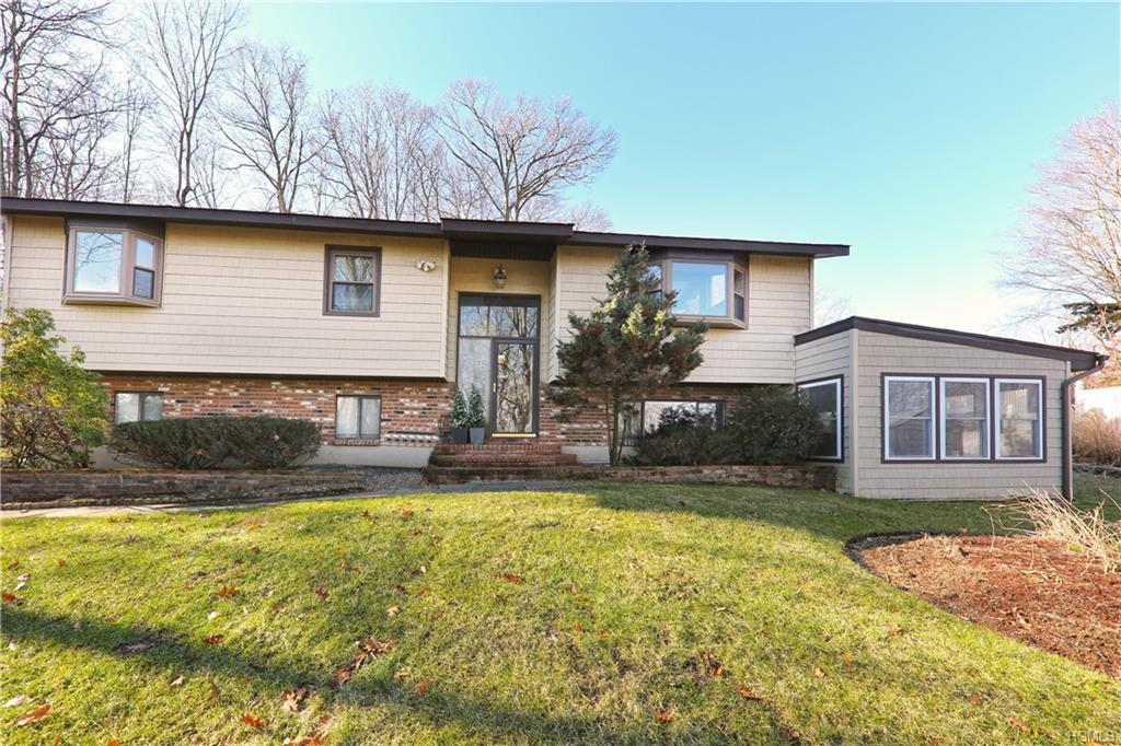 Spacious, and sun-filled 3 BR sits on over an acre of stunning grounds abutting the Blue Mountain Re