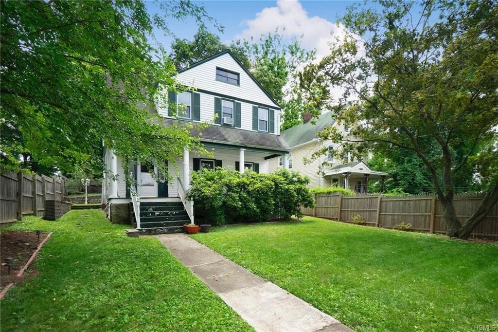 Charming updated 4 bedroom Colonial home with front porch. High Vaulted 9ft Ceilings.  Attention to