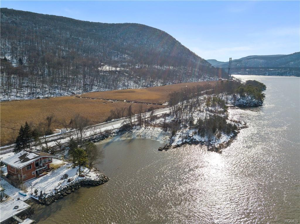 Raw Hudson Riverfront land with spectacular views of the Bear Mountain Bridge and Anthony's Nose. Lo