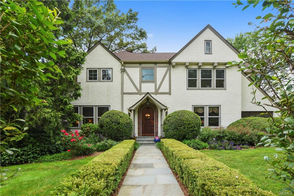 Upon entering this 1904 Contemporary Tudor you step back in time when homes were built by master cra