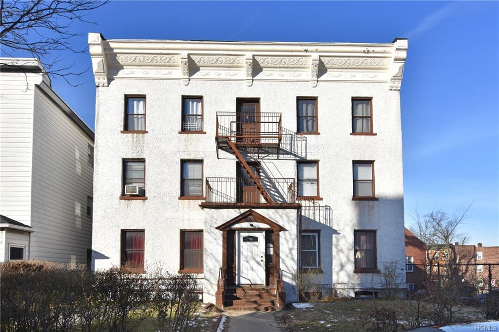 Investment opportunity is in a solid stucco multifamily apartment building in Historic Sleepy Hollow