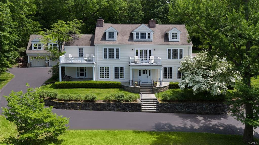 Panoramic Hudson River & distant hilltop views frame this spectacular country estate on 2+ acres of