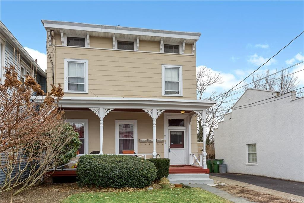 Charming 3 Family Village Colonial with off street parking in Historic Tarrytown recently designated