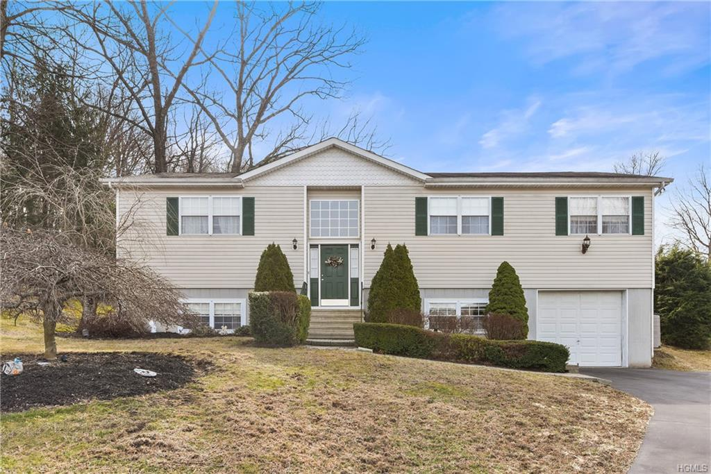 Impeccably maintained young raised ranch on culdesac. Impressive open concept floor plan for easy en