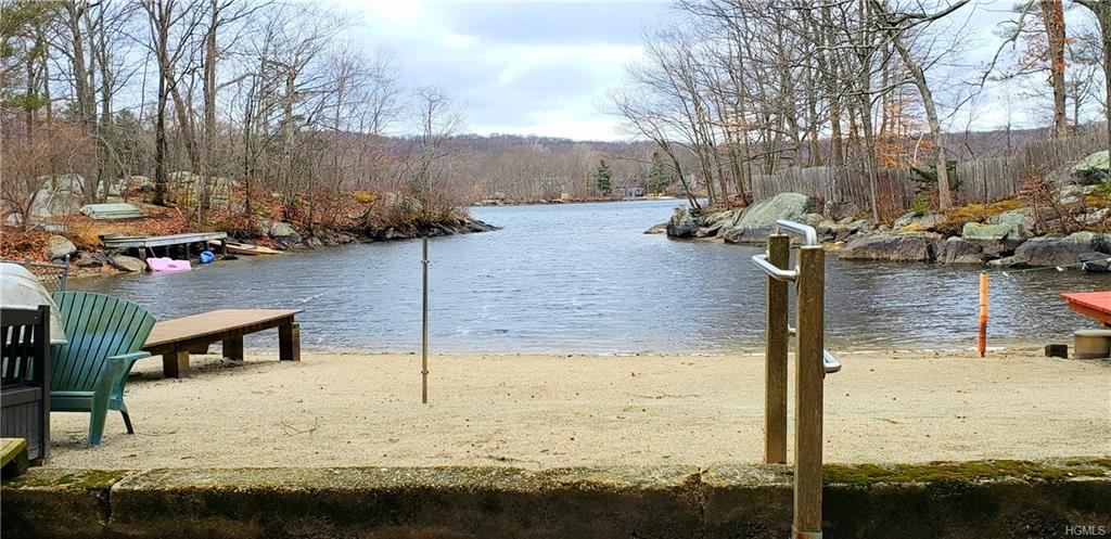 "Ok Here it is- Welcome to Your  Prestigious ""Roaring Brook Lakefront""  home ready for your TLC.. a p"