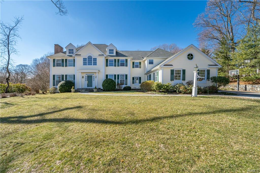 This sun-drenched custom-built 6 bedroom, 5.5 bath Colonial with park-like property is on a sought-a