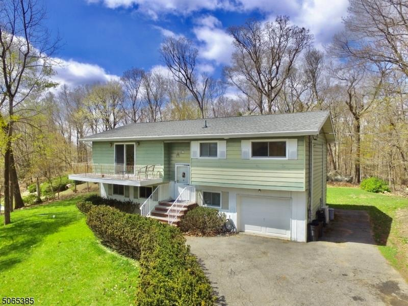 WOW! AWESOME 3 BEDROOM 1.5 BATH 1 CAR GARAGE BI-LEVEL SITUATED ON .46 OF AN ACRE WITH A NEW SEPTIC S