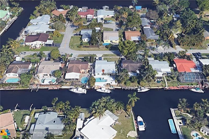 Ocean access: Beautifully updated 3 bed/2 bath/ 1 car garage w/ a pool in Dania Beach is perfect for South Florida living. Enjoy the split bedroom floor plan, open living areas, incredible water views from most of the rooms in the home, Hurricane Impact windows & doors, new roof & more. Kitchen is open to the dining area, has granite tops, SS appliances, lots of cabinets for storage, breakfast bar, & room for an island. Each bedroom is a great size & offers wood flooring & nice size closets. Master bedroom overlooking the water, custom bathroom w/ walk in