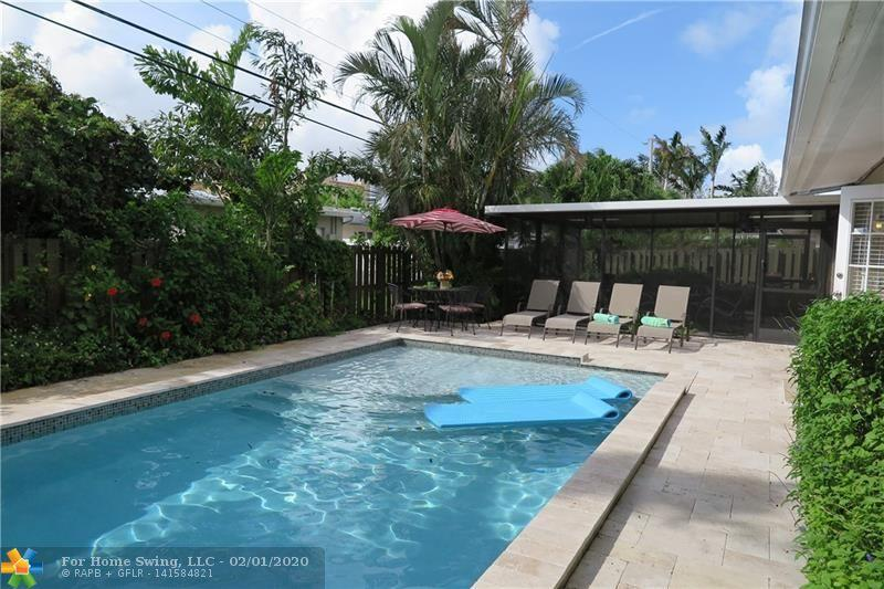 Wonderful outdoor living under large screened patio room overlooking your modern rectangular, new heated salt pool (2016) with sun shelf.  This 3 bedroom, 2 bath house is in the Central area of Wilton Manors in a sweet neighborhood north of the Starbucks and Rosie's.  Currently operating as a licensed vacation rental.  Furnishings are negotiable.  Open Kitchen / Living Room / Family Room-- nice flow.  One car garage and laundry room.  Tropical landscaping -- yep, it feels like you are on vacation!  Thinking of retiring here in a few years.... this could be