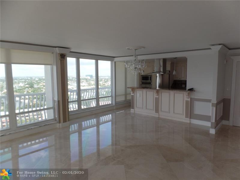 BEAUTIFULLY RENOVATED, LUXURY CORNER CONDO WITH OCEAN AND INTRACOASTAL VIEWS. WRAPAROUND  BALCONY AND FLOOR TO CEILING WINDOWS. GOURMET KITCHEN, STAINLESS STEEL APPLIANCES AND MARBLE FLOORS THROUGHOUT. AMENITIES. CLOSE TO SHOPPING, DINING, ENTERTAINMENT. LOTS OF GUEST PARKING. TENNIS COURT, HEATED POOL, UPDATED 'CLUB ROOM'. EASY TO SHOW. 24 HOUR SECURITY.