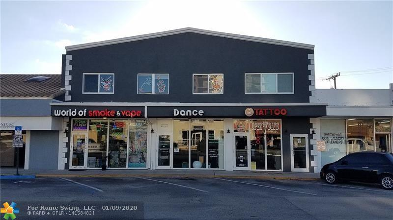 Completely remodeled building with new impact windows, roof, A/C. Polished concrete floors, high cei