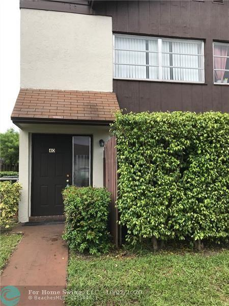 FANTASTIC OPPORTUNITY TO OWN A SEMI ATTACHED, CORNER UNIT TOWNHOUSE IN THE MODERNIZING COMMUNITY OF POMPANO BEACH.  THIS 2 BEDROOM 1.5 BATH HOME HAS BEAUTIFULLY NEW LAMINATE WOOD FLOORS AND UPDATED BATHROOMS---  GREAT OUTDOOR SPACE BOTH FRONT AND BACK - GATED COMMUNITY FOR YOUR PRIVACY IN THE EVERCHANGING POMPANO BEACH -- CLOSE PROXIMITY TO 95  LAST UNIT SOLD IN 5 DAYS!!