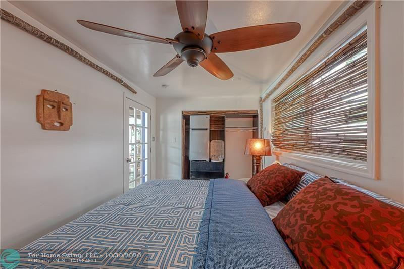 Located in a separate building is this nice studio bedroom with closet and refrigerator