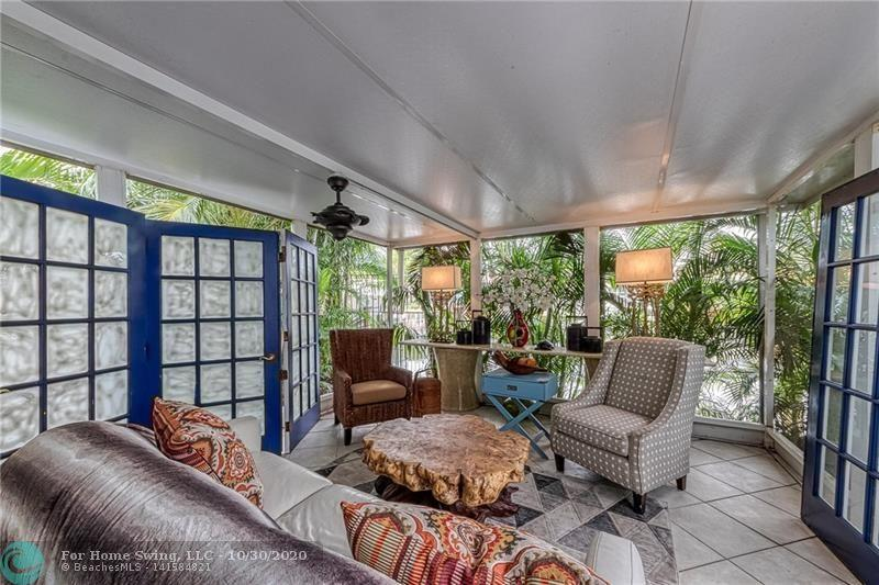 Private patio leads to dock and to the screened porch