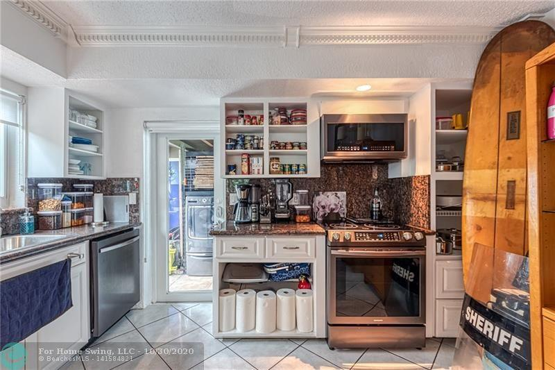 Nice large kitchen with granite countertops and lots of storage.