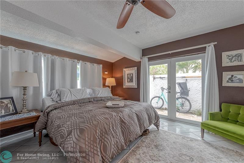 Large room with great view out to the pool and deck