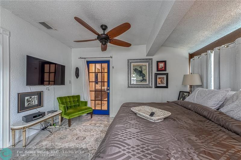Second guest room with king size bed and refrigerator in the closet.  Private .entrance