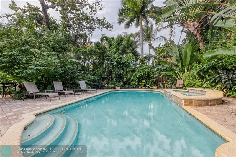 Located in desireable Central Wilton Manors, just 3.5 blocks from Wilton Drive!!  This 3 bed / 2 bath pool home sits on a large lot at 9,995sf -- a lush tropical paradise.  House has a true entry foyer, then open ups to the Living / Dining and Kitchen.  Large Master Bathroom with access outside to the pool area.  Screened porch sections across the back and side of the house creates lovely and relaxing areas to lounge.  Heated salt pool in a private setting - surrounded by mature landscaping.  Owner has done many expensive improvements to the house:  new roof June 2020, new impact windows and doors 2020, and new underground PVC sewer lines in 2020. Great location - come see this one, going fast!