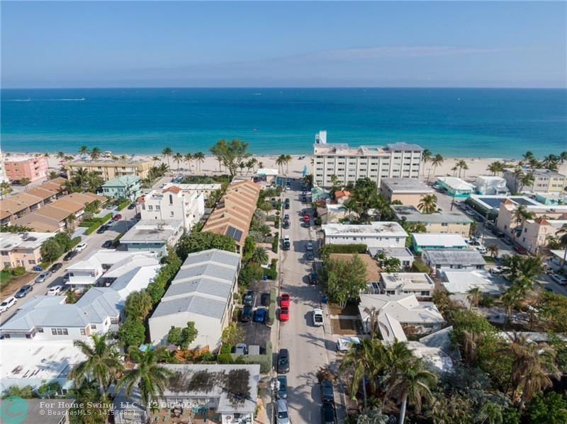 Enjoy Beach Living! Spectacular 3 bedroom/ 2.5 bathroom townhouse Steps From The Beach! Completely Remodeled with Impact Windows and Doors, New Roof 2018, New AC 2019, Full Rehab down to the studs 5 years ago with New Electrical and Plumbing Throughout! New Washing Machine, Open Floor Plan, Tile Floors Downstairs, Upstairs New Wood Flooring! Huge Master Bedroom With Sliding Glass Doors Overlooking the Intercoastal! Outside building was freshly painted! Could be sold furnished or unfurnished. Enjoy a nice walk or run every morning on the Fabulous Hollywood Boardwalk! Walking distance to shopping and fine dining! Perfect for Investors! You are able to rent out seasonal or yearly lease. Don't let this one pass you by! Click the link for the vi
