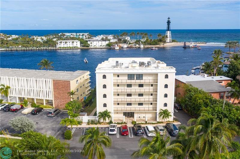 A Once-in-a-lifetime Opportunity! Spectacular opportunity to live at Hillsboro Inlet w/ ocean views & the most incredible parade of boats & beauty. With 2,300 sqft of interior living space, dockage, 3 beds/2.5 baths/in unit laundry, wood tile throughout, Hurricane Impact windows/doors, semi-private elevator & more. Large kitchen w/ breakfast area, bar seating, formal dining, stainless LG appliances & more. Relax on the 23 ft patio, go to the private beach, launch your kayaks & paddleboards & enjoy a unique & incredible lifestyle. Large primary bedroom  w/ a walk in closet & en suite bath. Second bedroom has en suite bathroom & walk in closet. Third bedroom is being used as an office. Parking space fits 2 cars, dockage available, all ages, w