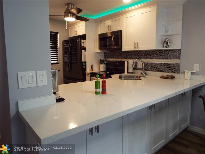 Beautifully Remodel - completed February 2020 - Updated Kitchen has White Shaker Wood Cabinets, a large center Island, Stainless Steel Appliance, Flooring all tile, Bathroom remodel new shower, flooring and cabinets.  New Closet Doors, Walk-in Closets, Enclosed Patio provides additional living area. Fabulous Clubhouse with resort style pool surrounded by Tiki Huts and beautiful green areas. Enjoy the fitness center, Tennis, Bacci, and other planned activities, theatre, concerts and more In this active 55 + Adult community. Centrally located off Sample Road