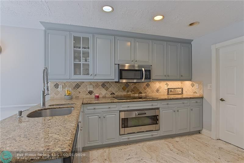 Luxurious upgraded 3 bed, 3 bath home located at the prestigious Guard Gated community in Meridiana at Boca Point. THE BEST ALL AGES GOLF COURSE COMMUNITY (Membership is not required)! This home features over 2,500 square feet & an ideal floor plan 1 bedroom & a full bath downstairs 2 bedrooms including master & 2 bathrooms upstairs! Eat-in Kitchen w/separate dining area, updated kitchen w/granite counter tops. High end finishes in kitchen & bathrooms.Wet bar & Fire place! Home is perfect for entertaining your friends & family. New A/C unit.  Private atriu