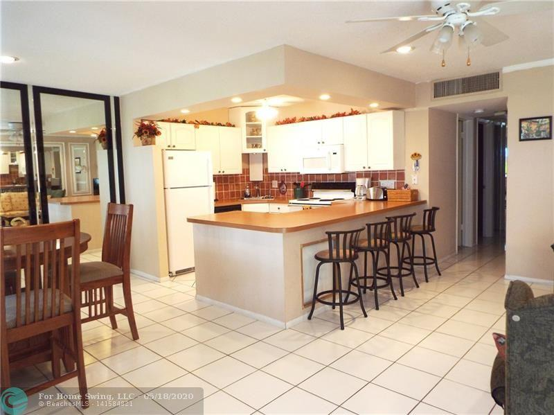 If you are looking for a break from all the craziness and want  warm and comfortable get-a-way place in the South Florida sun, this is it! This lovely community offers a well groomed property, heated pool, spa, walking ways to the pool and grounds, clubhouse, social activities, close to shopping, restaurants, beaches and transportation.  Comfortably furnished and offers cable and internet.  You are sure to enjoy your stay and enjoy Mayburry Mansion Unit E 109.  The condominium has a NO PET policy, but all age groups are welcome!  Convenient Parking just ou
