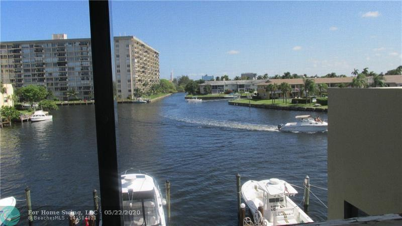FURNISHED ! TWO CARS, TWO TENNIS COURTS, FREE ASSIGNED BOAT DOCK INCLUDES WATER & POWER.  TWO STORY TOWNHOUSE IN CONDO COMPLEX, WITH SUNDECK ROOF TOP OFF MASTER SUITE.  BEST VIEW OF BAY AND WATER WAY ENTRY INTO INTRACOASTAL.  WASHER, DRYER, STORGE PANTRY, BAR, BEAUTIFULLY FURNISHED, TWO SCREENED BALCONIES.   RESORT STYLE COMPLEX. COVERED ASSIGNED PARKING SPACE, LIGHTED TENNIS COURTS, CLUBHOUSE WITH GYM, WI-FI, GENERAATOR, KITCHEN,  SHOWERS AND SAUNA.  GATE AND CAMERA SECURITY, HEATED POOL AND HOT TUB.   ONLY CONDO SURROUNDED BY WATERFRONT HOMES.    700 CRE