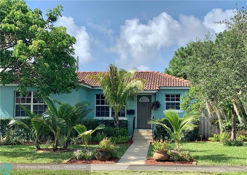 Enjoy living in this 3 bedroom 1.5 baths home with a large backyard in a convenient neighborhood.  3rd bedroom currently used as den. Hardwood floors and tile throughout the home.  The house is located on a nicely landscaped corner lot with off street parking in the gated backyard.  Large carport and play area. Easy access to I-95 and downtown West Palm Beach.  Video is available if you want preview before going.  Just contact agent.