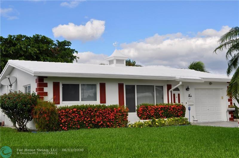 Look No Further...You've Found it! Less than 3 miles from the Newly Revitalized Pompano Beach, this is one of the Nicest Homes in Leisureville! Move-in Ready, this home has been lovingly cared for, and it shows! Pretty gardens surround, with thoughtful details evident throughout, plus lots of extra storage and plenty of space for everyone to park on your doublewide pavered driveway. Most of the windows and the garage door are IMPACT.  Enjoy low HOA Fees in this 55+ Active community with 2 Clubhouses, 2 Pools, a 9-Hole Golf Course free to residents, a Sauna