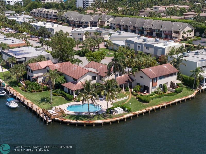 Live the Boating and Beach Lifestyle in this one-of-a-kind Magnificent 2-story townhome on a Point Lot with direct Water views of the all year long action of the Intercoastal, combined with the tranquil and peaceful views of the Natural Preserve. Located East of the ICW. This property also offers the same incredible views from the private pool, with Dockage (when available) on a wide canal and parking available for up to 2 cars, one located outside front door. Renovated Kitchen, many other upgrades. Its a must see!!! Beaches are conveniently located down t