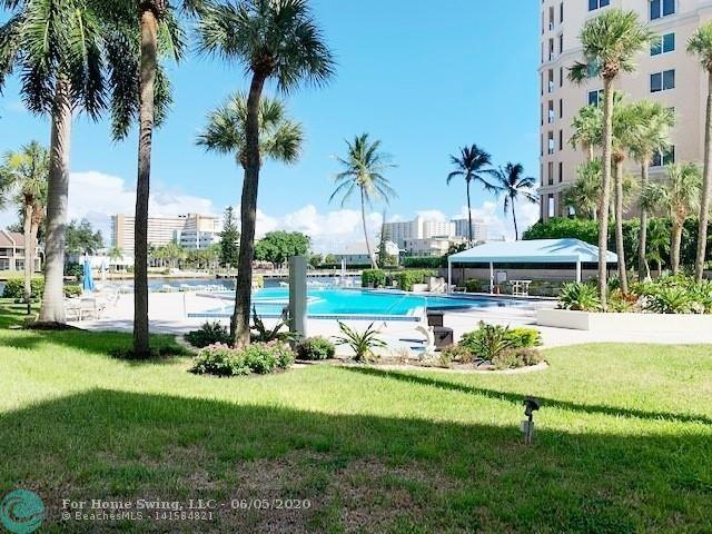 PRICED FOR QUICK SALE! Enjoy Florida lifestyle watching a daily parade of boats & resort heated pool at waters edge. Enjoy coffee/wine on your 39' patio tucked in a corner w/easy access to backyard, pool & BBQ. Rarely available ground floor 1750 sq ft unit with home a home like feel looking SE to pool & Intracoastal. Open floor plan, split bedroom unit, eat-in open kitchen with pantry, huge walk-in closet & dressing area with separate bath in master suite, laundry room with full size W/D, 24/7 sec, garage parking, guest parking, gym, sauna, car wash area, 2 pets up to 25lbs welcome! Most sought after building on the West side of the Intracoastal so no waiting on the bridge. Located 2 short blocks to the beach, restaurants, shopping, boat ra